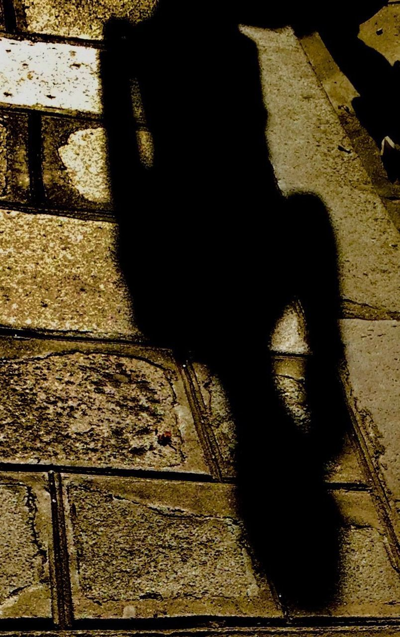 shadow, focus on shadow, outdoors, real people, day, sunlight, one person, one man only, low section, men, only men, people