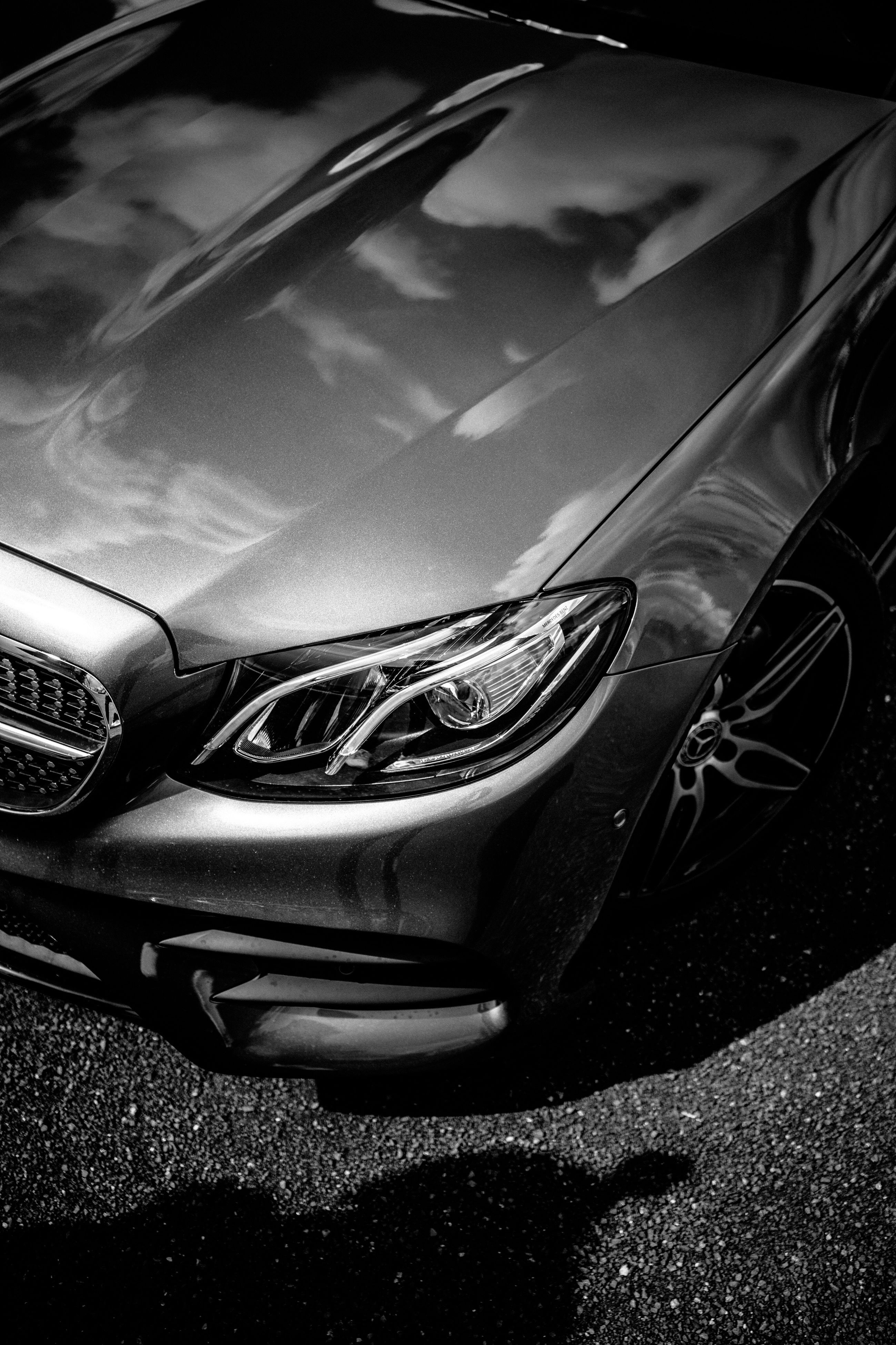 car, land vehicle, transportation, mode of transport, reflection, outdoors, close-up, vehicle part, day, no people