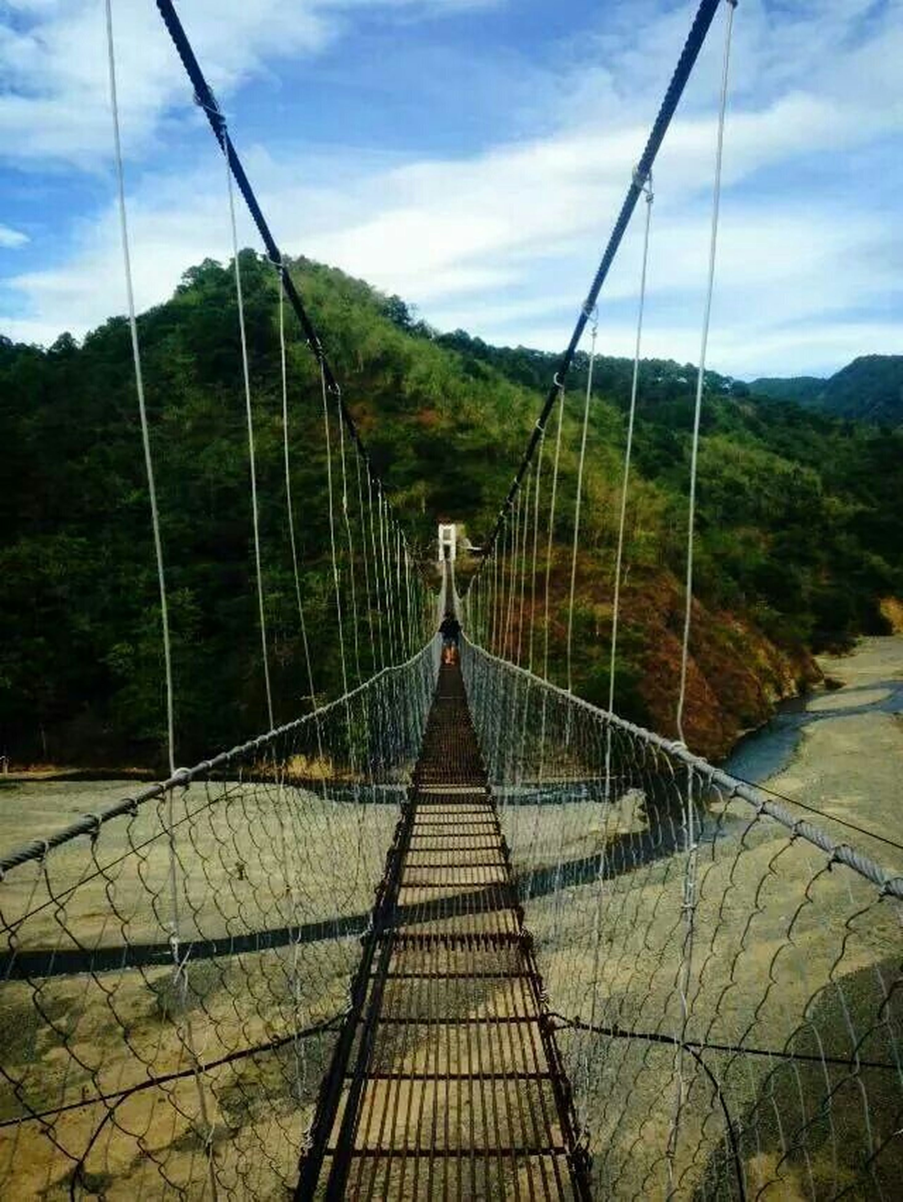 the way forward, sky, connection, railing, diminishing perspective, cloud - sky, mountain, bridge - man made structure, vanishing point, cloud, transportation, tree, footbridge, tranquility, tranquil scene, day, nature, cloudy, outdoors, metal