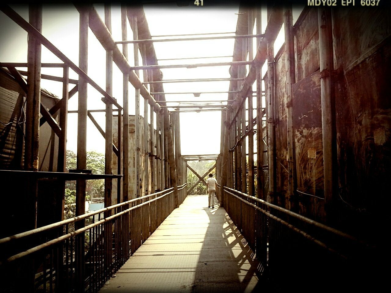 railing, built structure, the way forward, architecture, bridge - man made structure, day, sunlight, no people, footbridge, indoors, sky