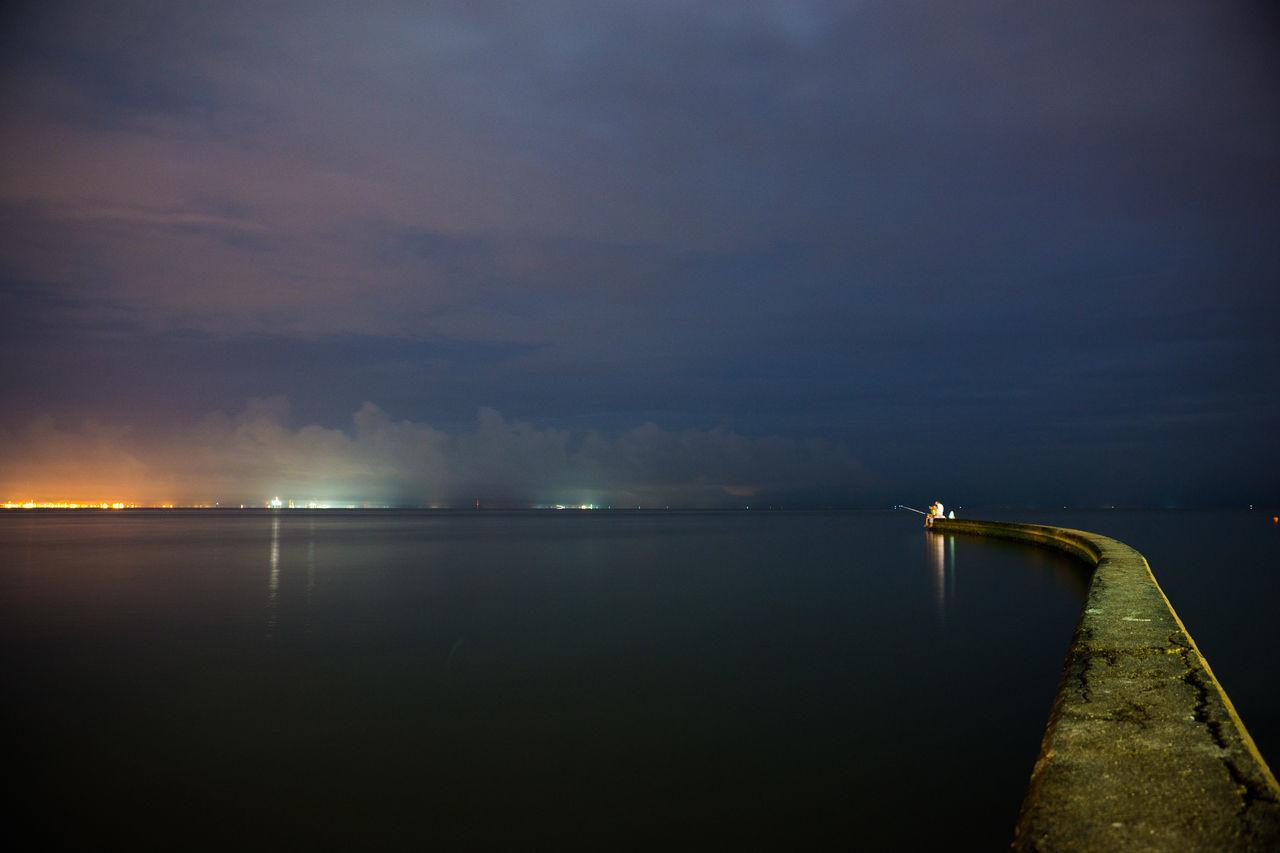 Fisherman Illuminated Light Night Outdoors Sea Water