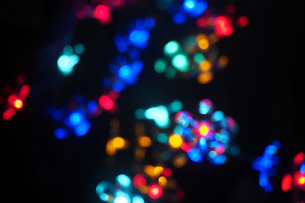 colorful unfocused lights on black background Christmas Christmas Decoration Color On Black And White Colorful Colorful Lights Defocused Desfocado Electricity  Glowing Lighting Equipment Lights And Shadows Lights In The Dark Luzes Luzes Coloridas Natal Unsharp