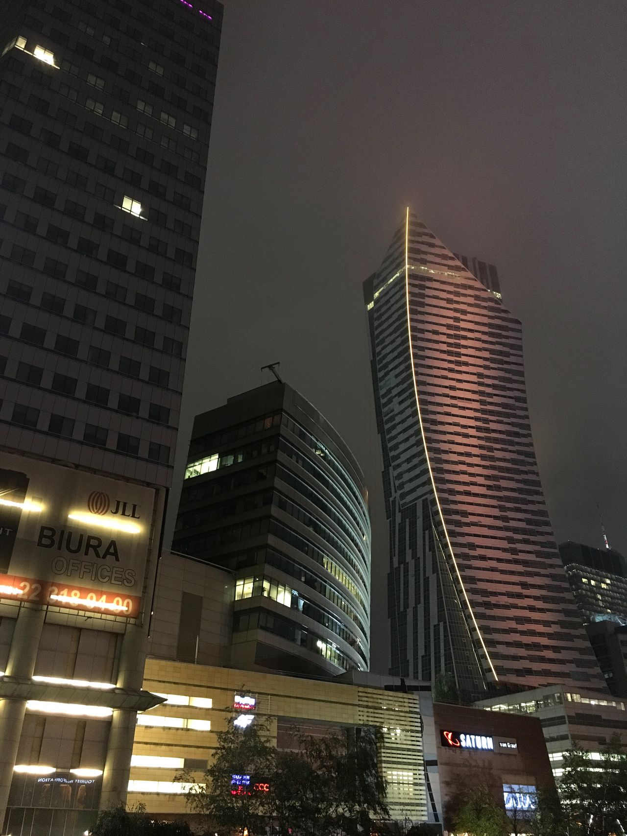 Warsaw Architecture City Skyscraper Building Exterior Illuminated Low Angle View Built Structure Modern Night Tower City Life Travel Destinations No People Financial District  Outdoors Tall Urban Skyline Office Building Exterior Cityscape Sky