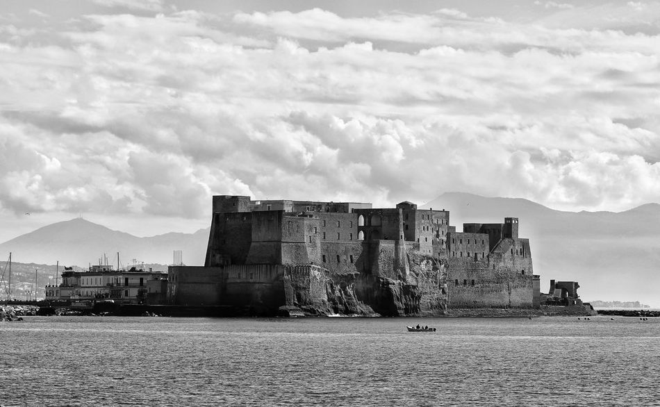 The Castel dell'Ovo, the oldest castle of the city of Naples and is one of the elements that most stand out in the famous view of the gulf. It is located between the districts of San Fernando and Chiaia, opposite Via Partenope Cloud - Sky Architecture Built Structure Sky Outdoors No People Day Napoliphotoproject Street Monochrome Napoli Napoli ❤ Naples History Architectural Column Architecture Visiting Travel Destinations Monochrome Photography Streetphotography City Holiday Architecture_collection architettura First Eyeem Photo