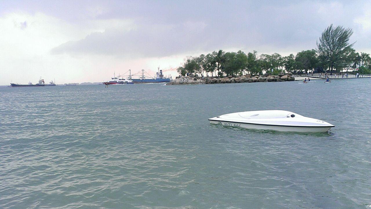 Summer Views lonely capsized boat @ Siloso Beach Boat Beachphotography Beautiful Nature EyeEm Nature Lover