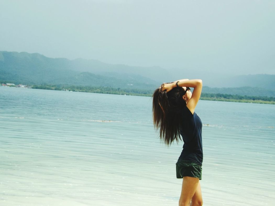 Long Hair Sea Side View Lifestyles Leisure Activity Casual Clothing Scenics Beauty In Nature Nature Vacations Carefree Water Sea View Sky Fun Beach Whitebeach Travel Visit