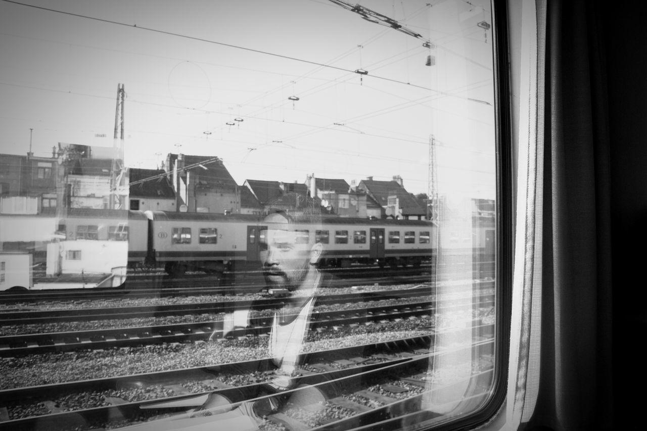 Reflection Of Man Seen On Train Window