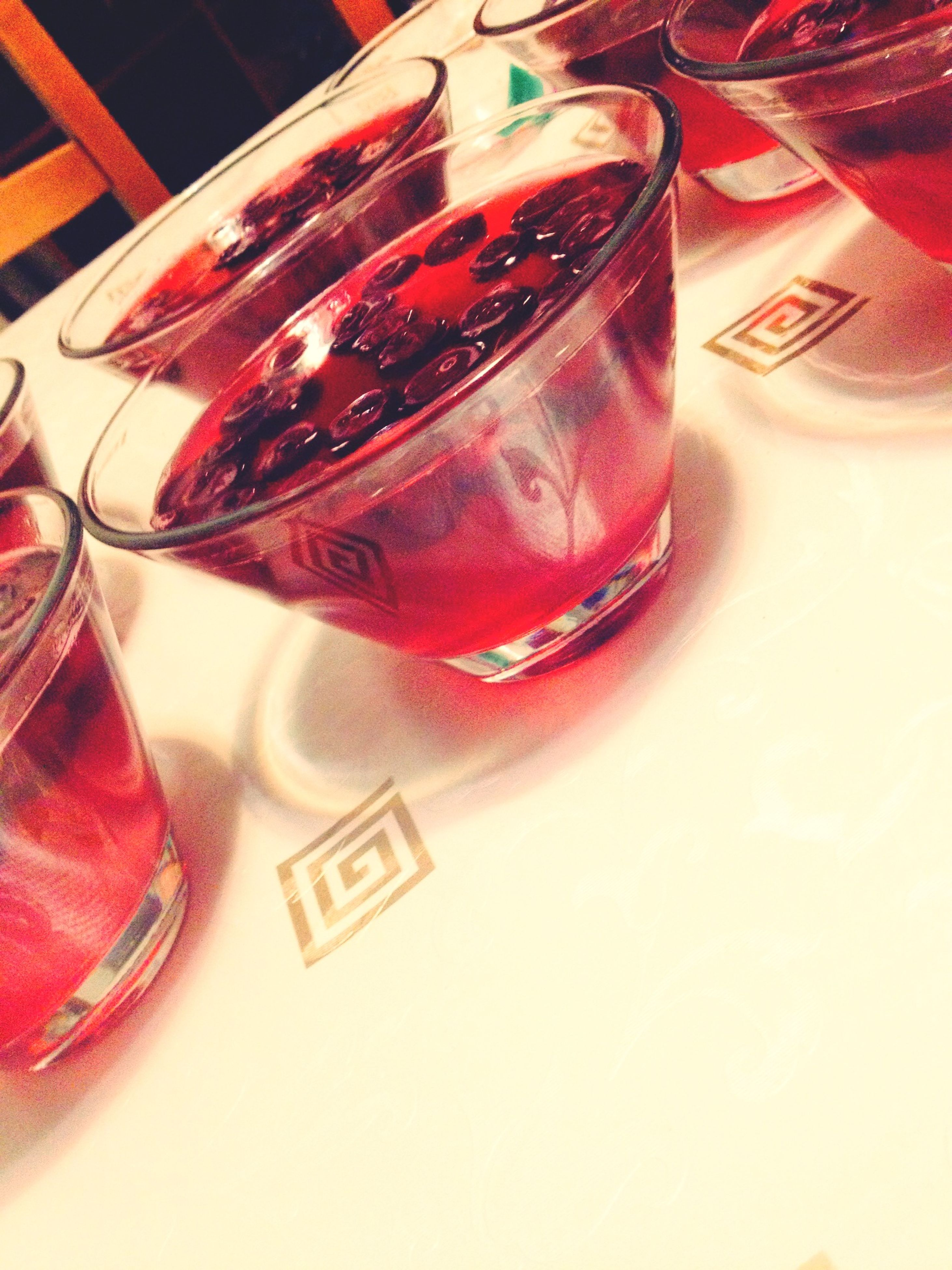 indoors, close-up, text, table, communication, still life, western script, sunglasses, high angle view, drink, red, reflection, food and drink, eyeglasses, part of, refreshment, glass - material, leisure activity