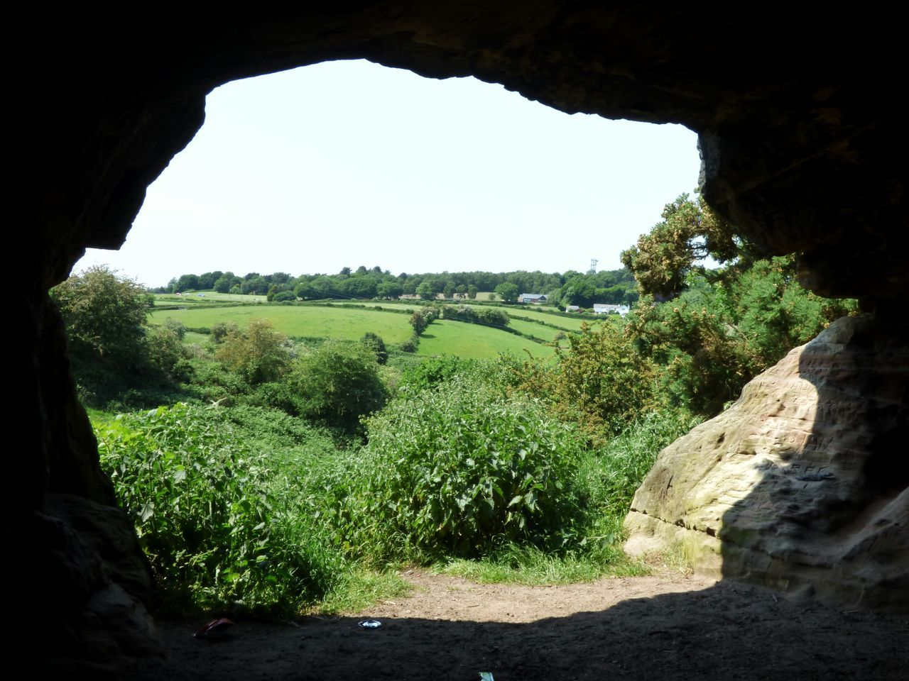 Looking out of a cave in Frodsham, Cheshire // Beauty In Nature Cheshire Day EyeEm Best Shots Eyeem Market Green Color Growth Hill Inside Cave Landscape Mike Whitby Nature No People Plant Scenics Sky Stock Image Stock Photo Stock Photography Sunlight Taking Photos Taking Pictures Tranquil Scene Tranquility Tree