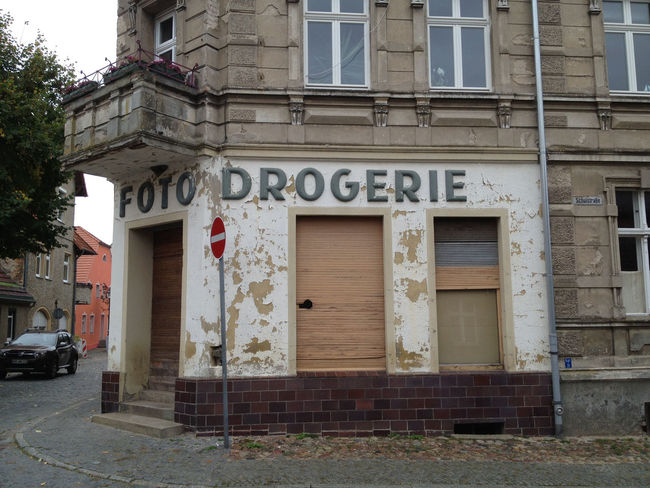 Architecture Brick Wall Building Building Exterior Built Structure Closed Culture DDR Door Drogerie Entrance Exterior Façade GDR Historic History House Remnants Of Socialism Ruined Text Wall Western Script Window