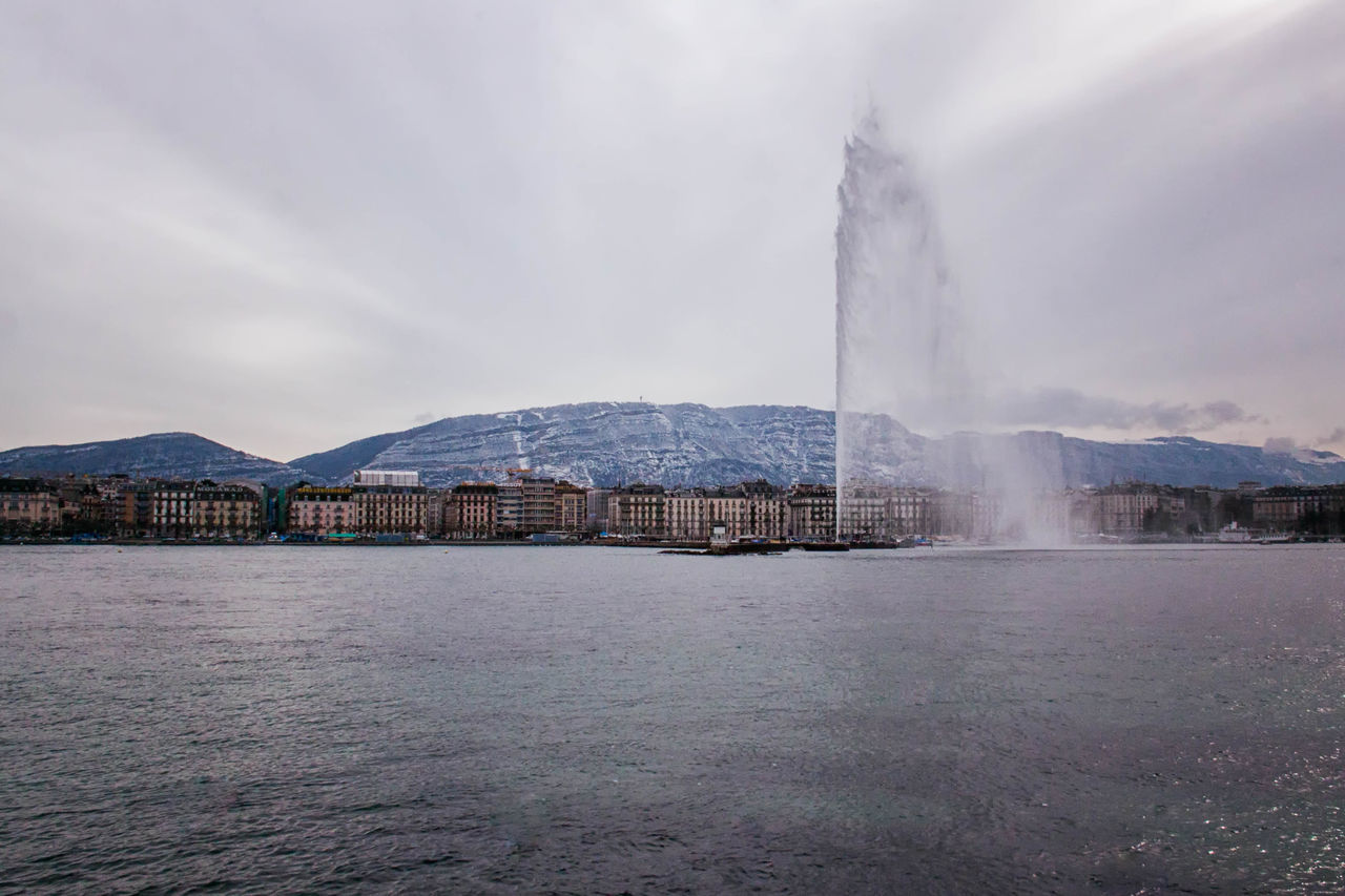 Geneva Fountain Distant Fog Fountain, Water, Spurt, Lights, Round, Circle, Geneva, Switzerland, Europe, European, Geneva Lake, Lake, Water, Seagulls, Birds, Mountains, Cloudy, Clouds Lake Lakeshore Non-urban Scene Outdoors Power In Nature Reflection River Scenics Sky Speed Standing Water Tourism Tranquil Scene Tranquility Tree Voyage Water Waterfront