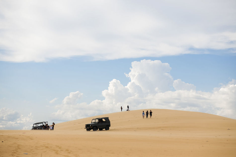 White Sand Dunes, Mui Ne, located in the south of Vietnam. It's about 5-hour away from Ho Chi Minh City. Adventure Arid Climate Beauty In Nature Cloud - Sky Desert Muine, Vietnam  Muito Outdoors Sand Sand Dune Travel Destinations Unrecognizable Person White Sand Dunes