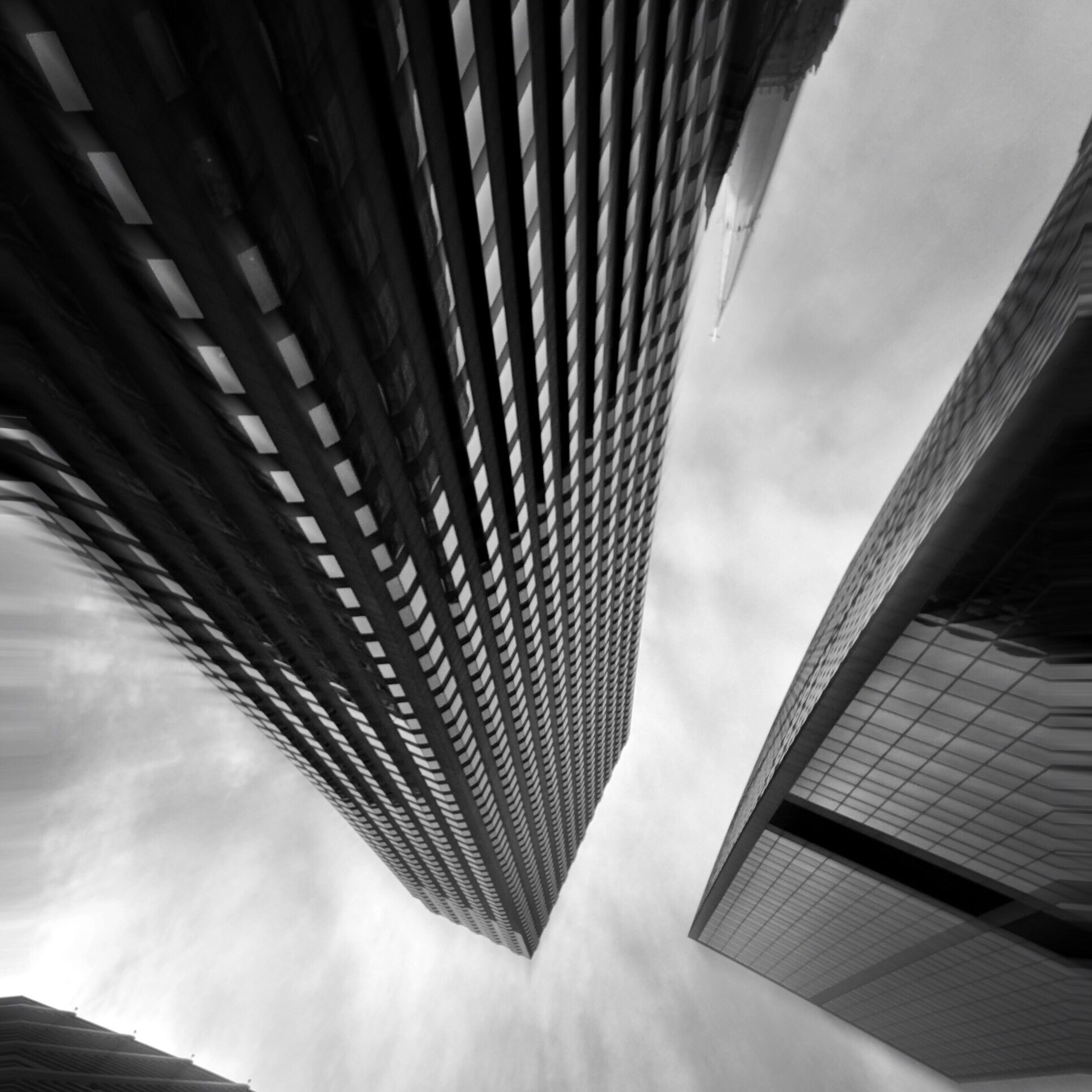 low angle view, architecture, sky, built structure, cloud - sky, cloud, building exterior, repetition, modern, cloudy, day, architectural feature, outdoors, tall, tall - high, office building, skyscraper, diminishing perspective, no people