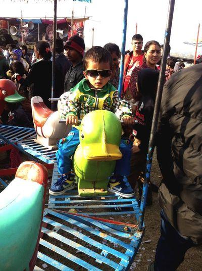My son rideing bike at fun park in chitwan festival 2071 NEPAL