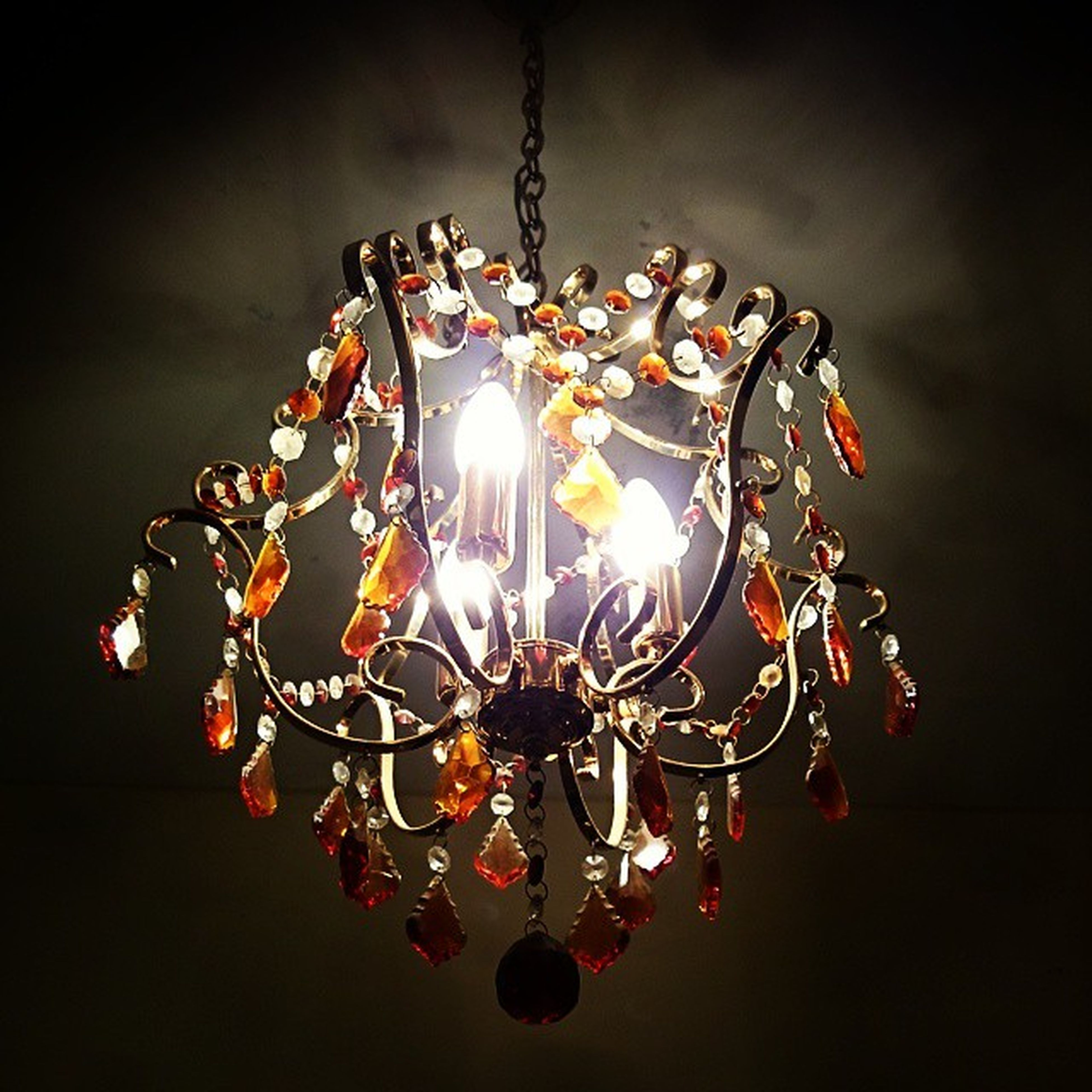 illuminated, hanging, decoration, indoors, lighting equipment, low angle view, chandelier, decor, glowing, electricity, ceiling, celebration, design, night, light bulb, close-up, tradition, pattern, light - natural phenomenon, electric light