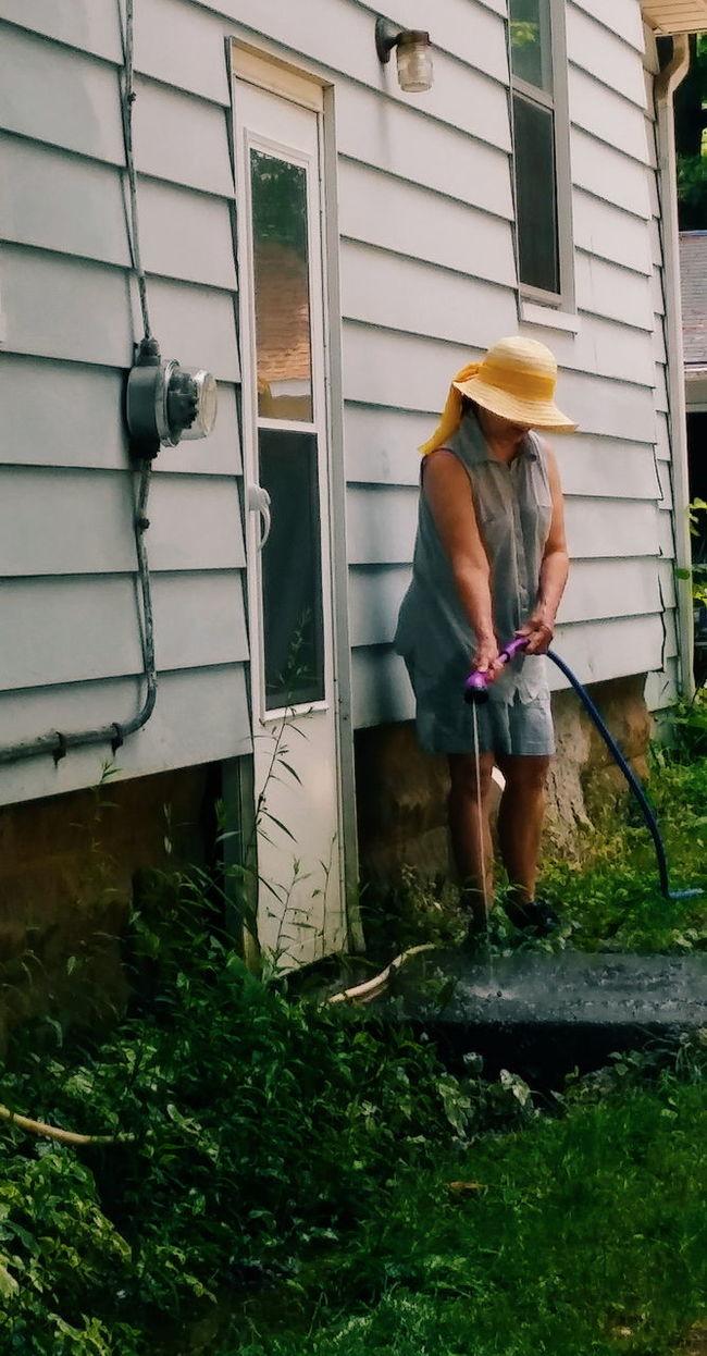 Yellow Hat Spraying Water Jackson Michigan Water Hose