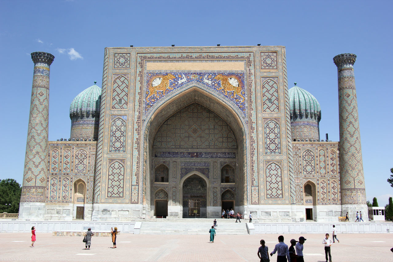 Activity Arch Architecture Building Exterior Built Structure Clear Sky Day History Islamic Islamic Architecture Islamic Art Lifestyles Madrassa Minaret Outdoors People Real People Registan Samarkand Samarqand Silk Road Tourism Travel Destinations Uzbekistan Vacations