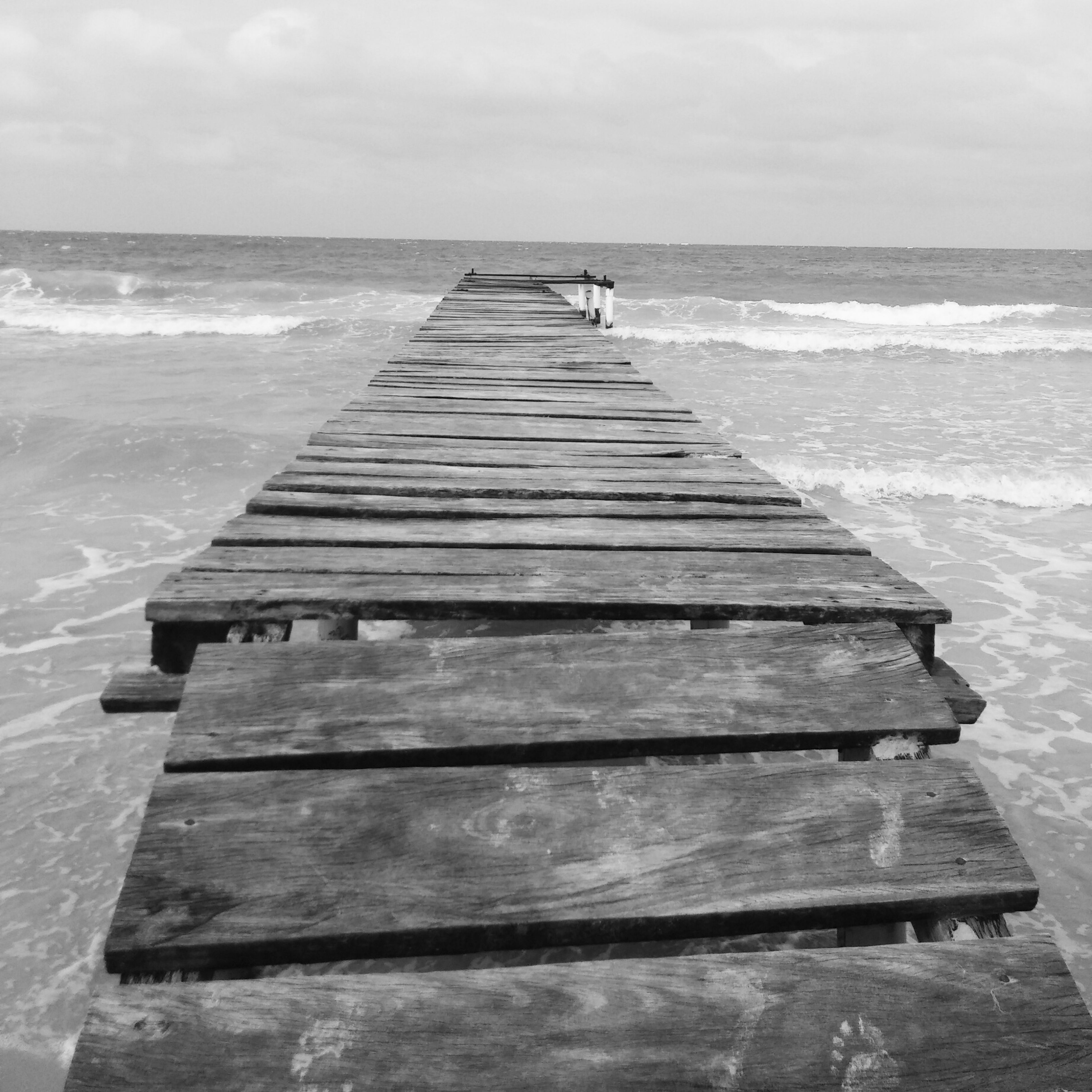 sea, horizon over water, water, sky, pier, steps, beach, wood - material, scenics, tranquility, tranquil scene, nature, staircase, beauty in nature, railing, shore, jetty, wave, day, idyllic