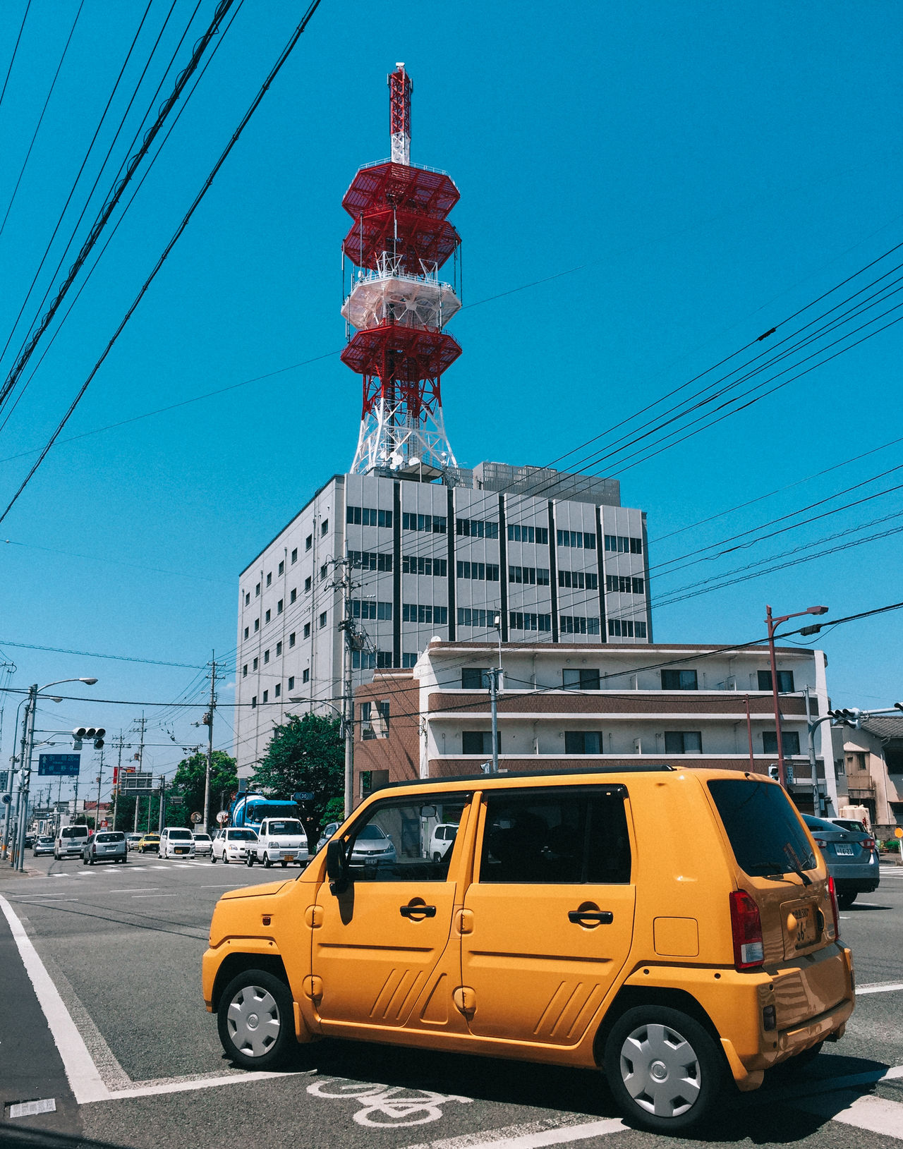 // random yellow love // Architecture Blue Building Exterior Built Structure BYOPaper! Cable Car City Clear Sky Day Electricity Pylon EyeEm Best Shots IPhoneography Japan Land Vehicle Outdoors Sky Skyscraper Street Photography The Street Photographer - 2017 EyeEm Awards Transportation Ultimate Japan Yellow Yellow Color Yellow Taxi
