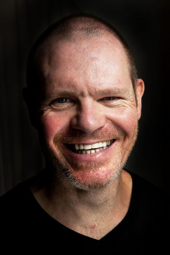 Black Background Cheerful Facial Hair Happiness Headshot Human Face Looking At Camera Males  One Man Only One Person Portrait Smiling Thinning