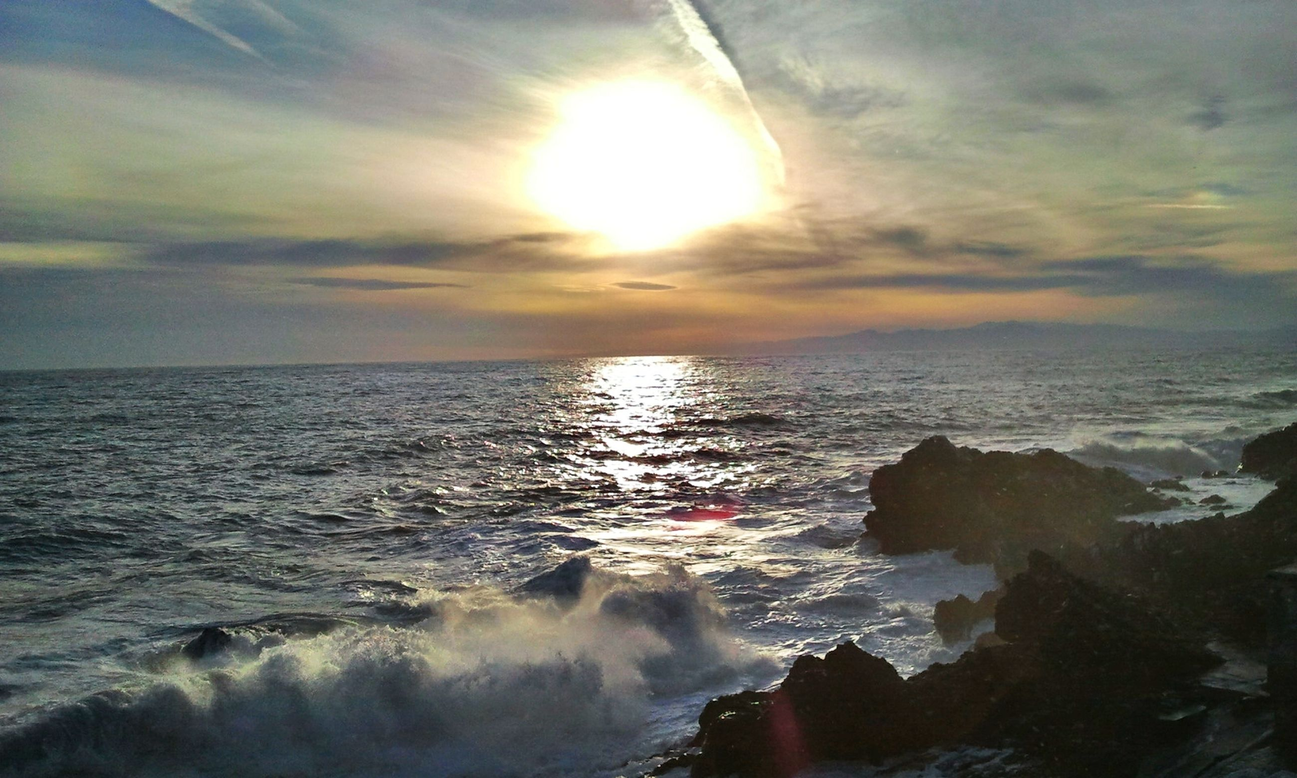 water, sea, scenics, horizon over water, sky, beauty in nature, sunset, wave, tranquil scene, sun, tranquility, nature, cloud - sky, idyllic, waterfront, sunlight, sunbeam, reflection, rock - object, surf