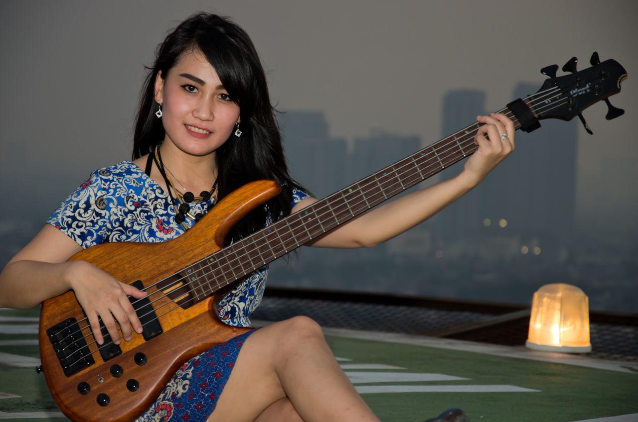 The Portraitist - 2016 EyeEm Awards Rooftop Bass Player