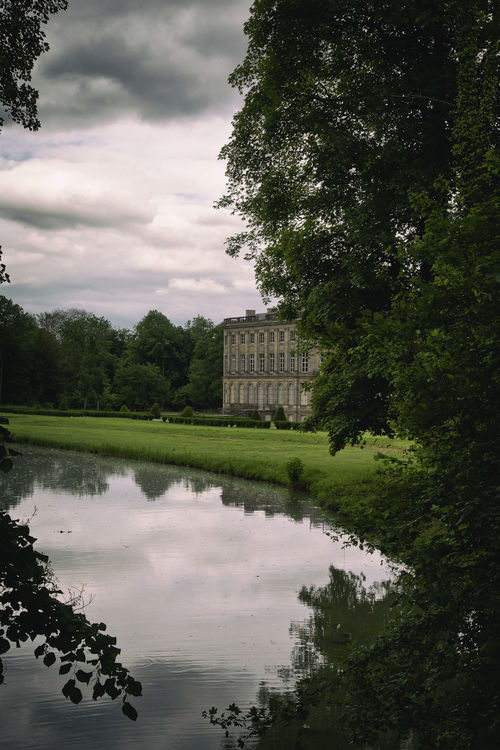 Chateau, big house castle in French isolated and surrounded by big green garden BIG Castle Château Cloudy Sky Entrance Europe France Garden Green House Invited Isolated Luxury Path Private Property Real Estate Renaissance Season  Sky Trees Visite Way