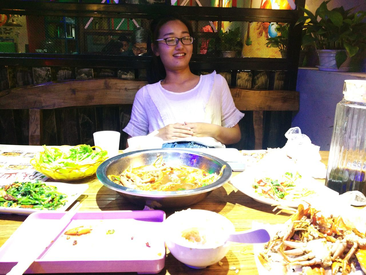 food and drink, front view, one person, real people, food, table, freshness, indoors, looking at camera, portrait, day, sitting, young adult, people