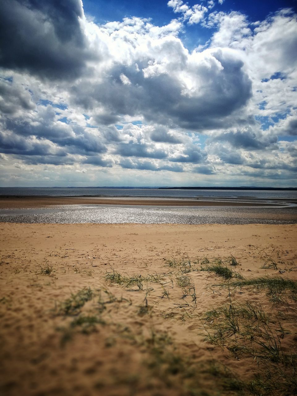 cloud - sky, sky, sand, beach, nature, beauty in nature, scenics, tranquility, sea, tranquil scene, landscape, water, no people, day, outdoors, horizon over water