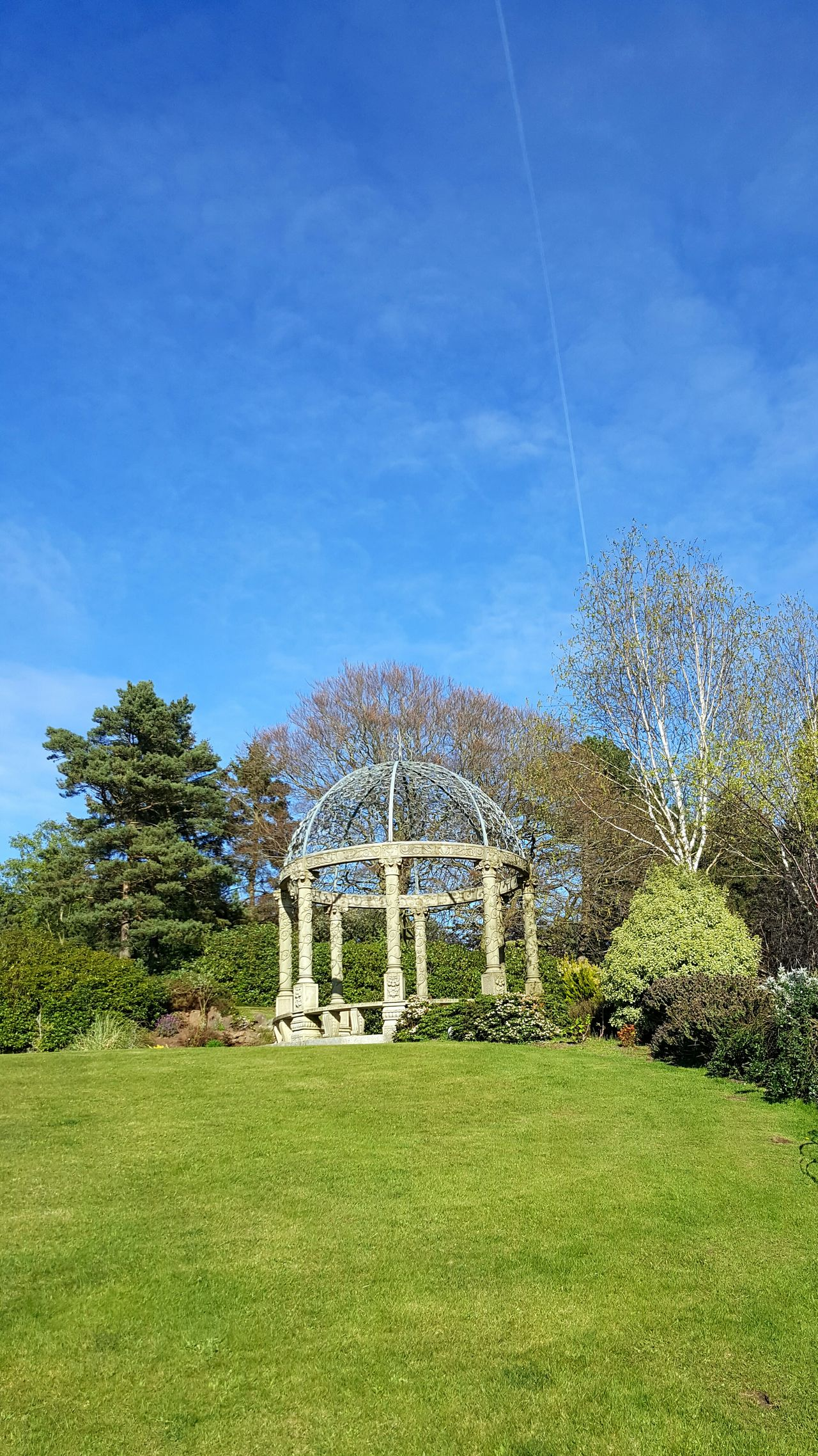 Green Color Blue Grass Sky No People Outdoors Day Nature Pergola Band Stand Garden Structure Luxury Luxury Hotel Grandeur Architecture Beauty In Nature