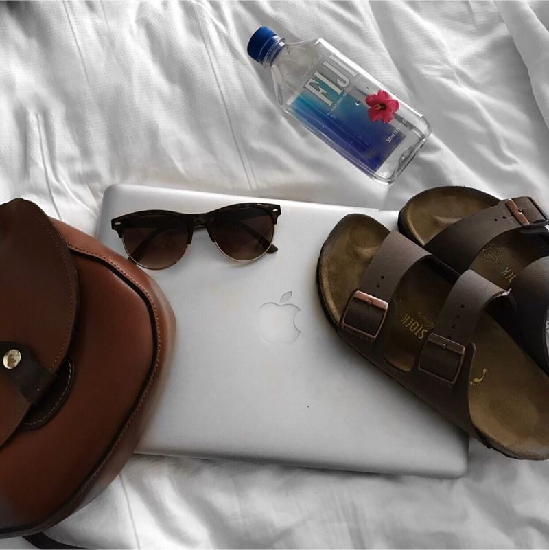 | Q: what are your travel essentials | A :my travel essentials included birks a bad sunglasses my macbook and of course my cannon camera i took this on | Travel Leather Indoors  Indoor Photography Bag Birkenstock StillLifePhotography Still Life Essentials Travel Travel Essentials MacBook No People Handmade Puerto Rico Let's Go. Together. Water EyeEm Selects Sommergefühle