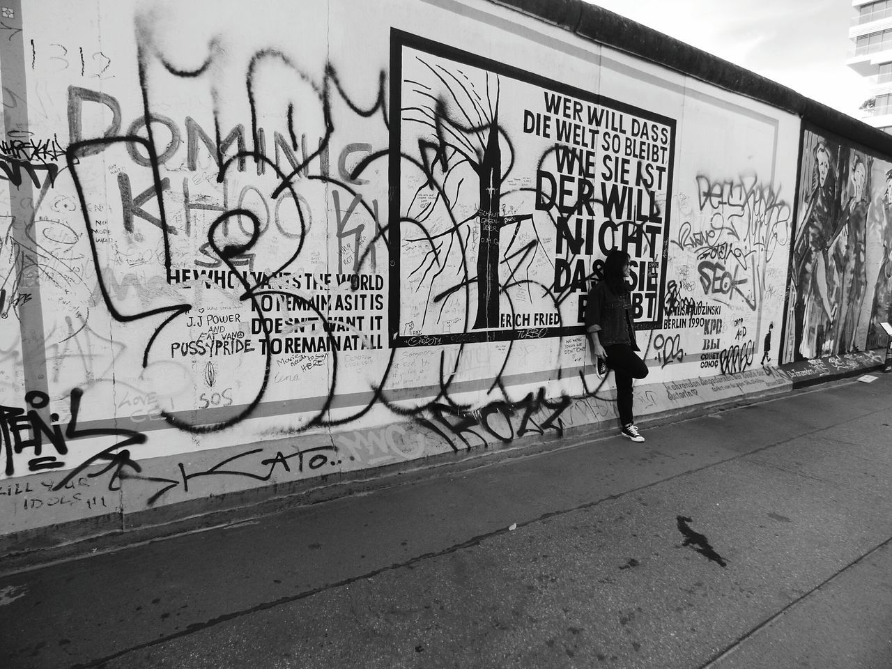 graffiti, real people, text, full length, art and craft, architecture, built structure, one person, walking, artist, building exterior, men, lifestyles, women, day, outdoors, standing, city, people
