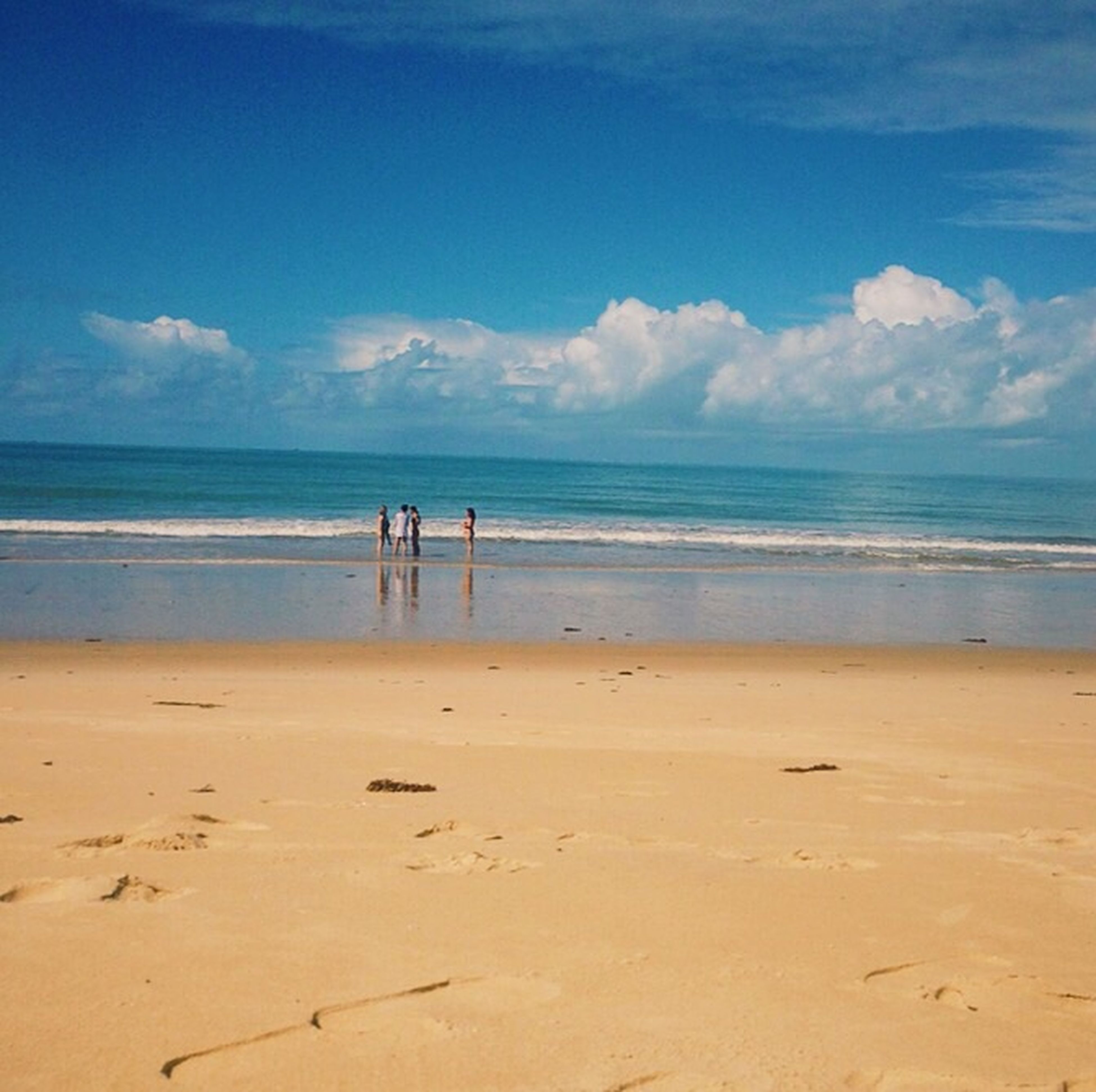 sea, beach, horizon over water, sand, shore, water, sky, scenics, tranquil scene, tranquility, beauty in nature, blue, nature, vacations, idyllic, cloud, cloud - sky, incidental people, leisure activity