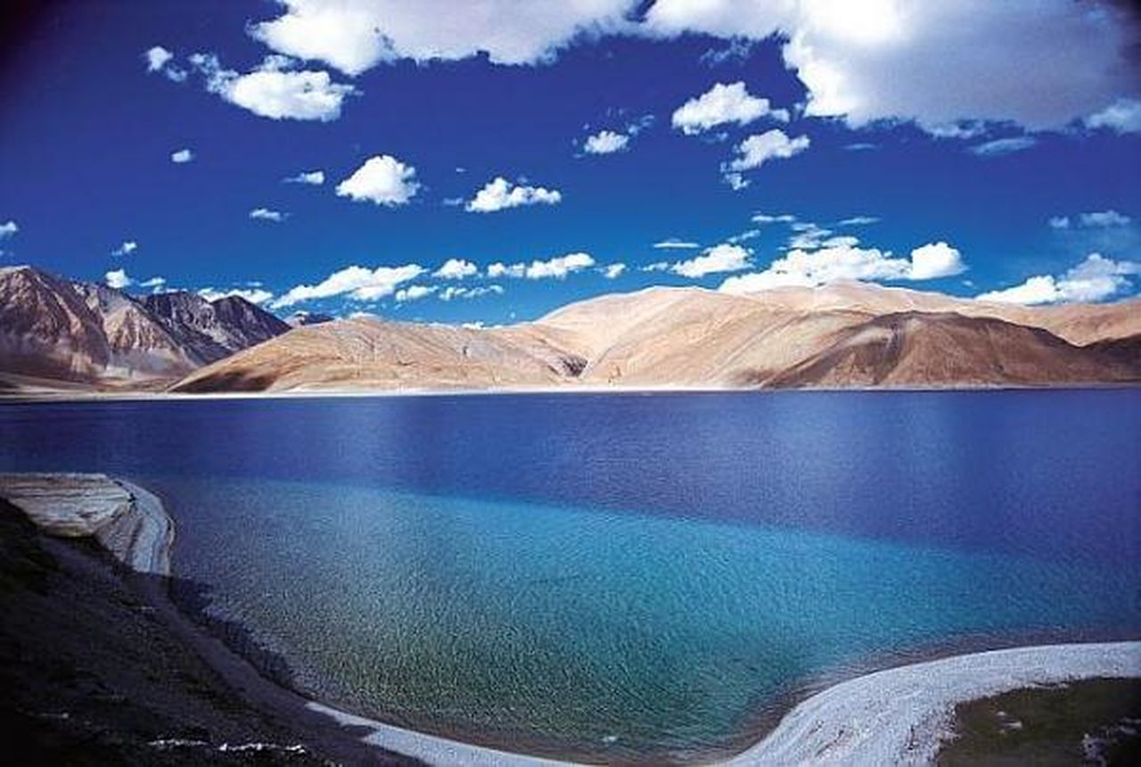 lake, mountain, water, mountain range, nature, scenics, beauty in nature, landscape, snow, glacier, outdoors, physical geography, cloud - sky, snowcapped mountain, travel, travel destinations, no people, awe, day, desert, beauty, sky, tundra
