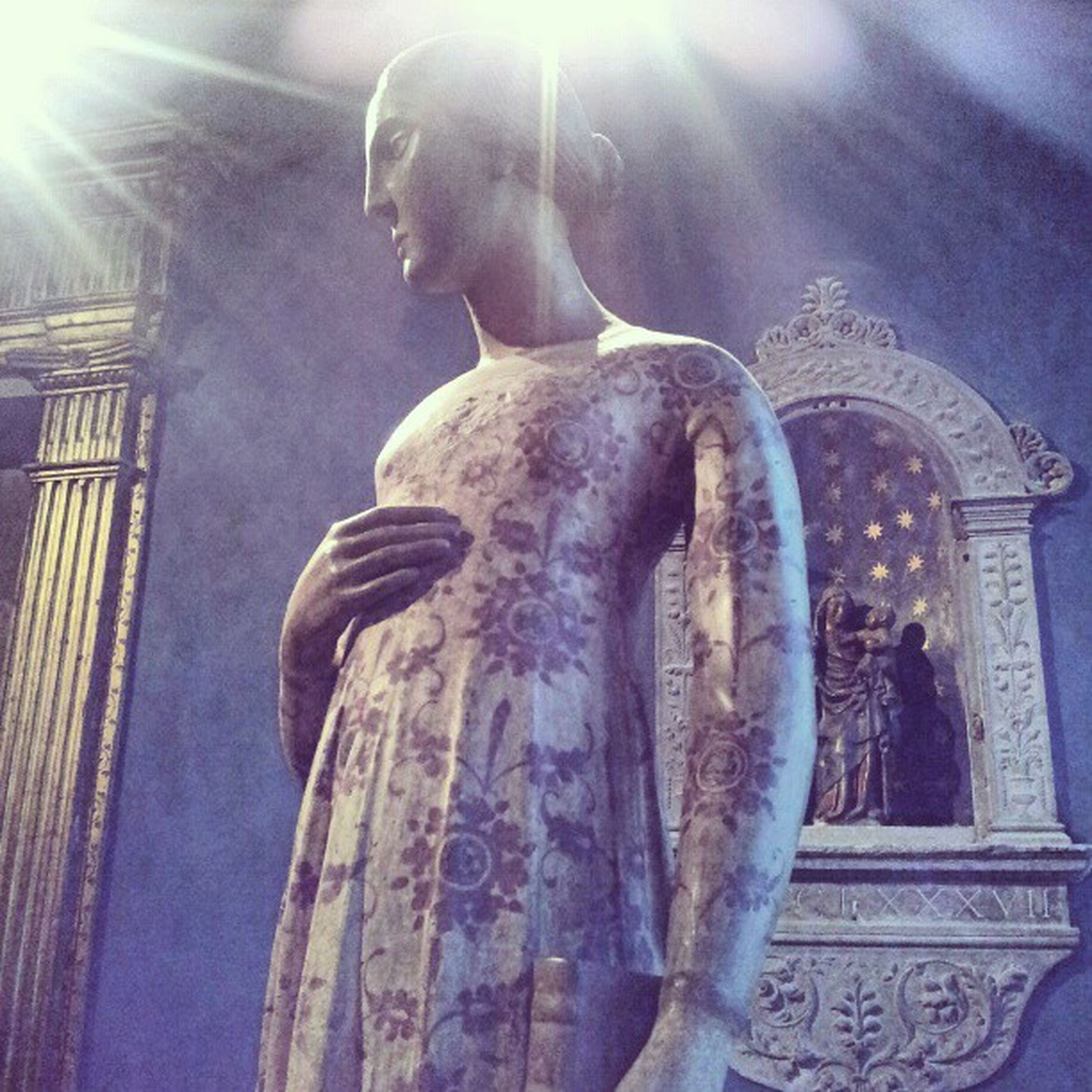 statue, sculpture, human representation, art and craft, art, creativity, low angle view, religion, built structure, spirituality, architecture, carving - craft product, sunbeam, famous place, fountain, craft, sunlight