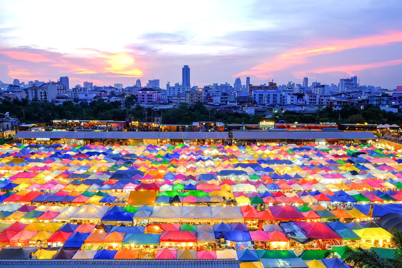 Train Night Market Ratchada. One of the popular shopping and tourist attractions at night in Bangkok. Attraction Bangkok Building Exterior Buy City Cityscape Cloud - Sky Landmark Market Marketplace Multi Colored Nightlife No People Outdoors Ratchada Second Hand Selling Shopping Sky Skyscraper Sunset Tent Travel Umbrella Walking Street