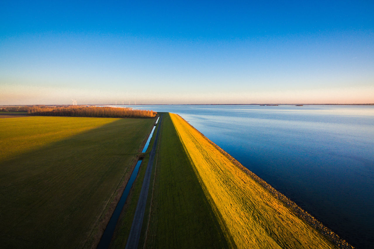 Sunset Blue Sky Landscape Road No People Horizon Scenics Outdoors Nature Agriculture Drone  Day Parallel Symmetrical Symmetry Dronephotography Drone  Lake View Lake Holland Dutch Dutch Landscape Dutch Skies Transportation