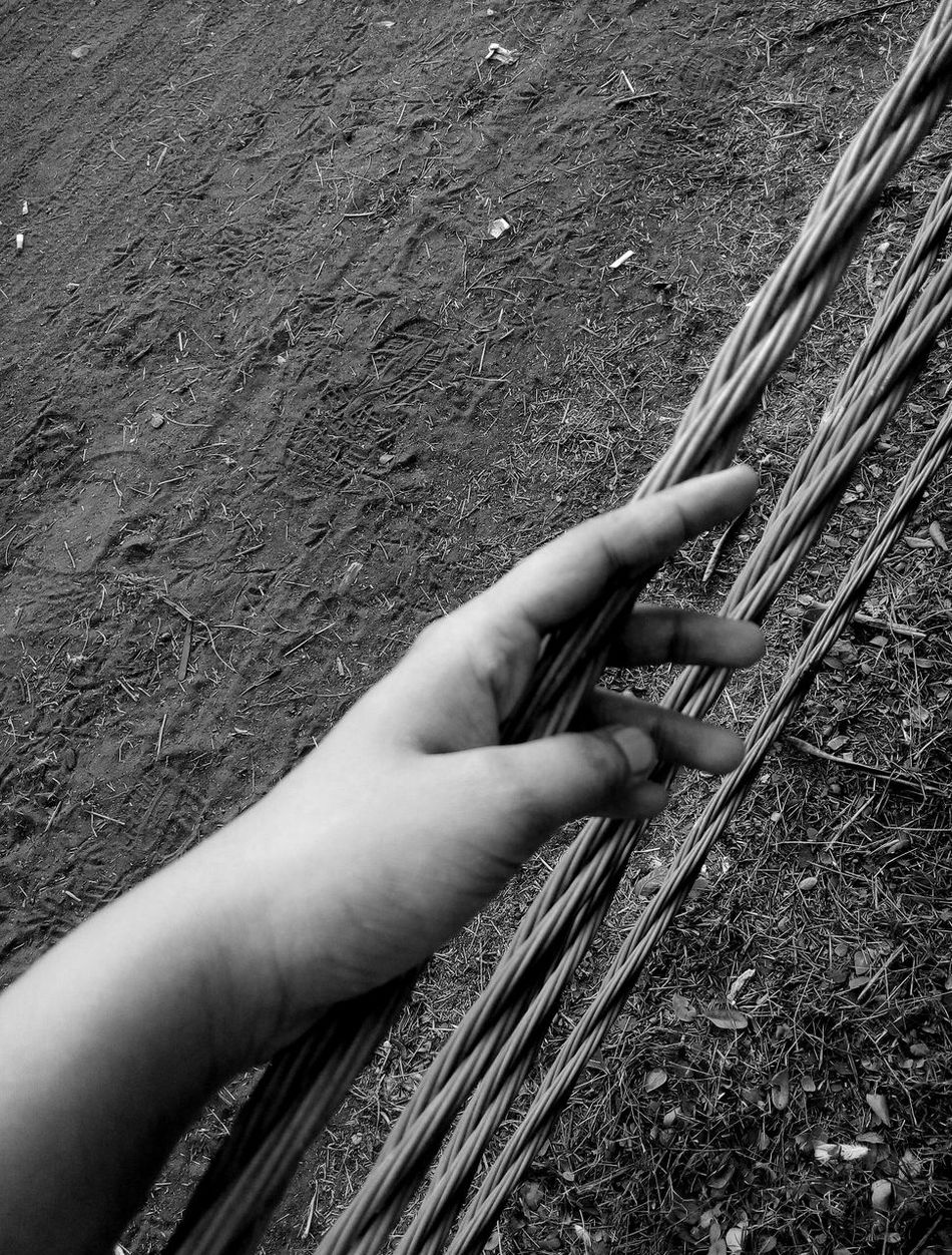 Awesome_shots Blackandwhite Blackandwhite Photography Day EyeEm Gallery EyeEm Nature Lover Grass High Angle View Holding Human Body Part Human Hand Nature One Person Outdoors Peaceful Real People Transportation Wire