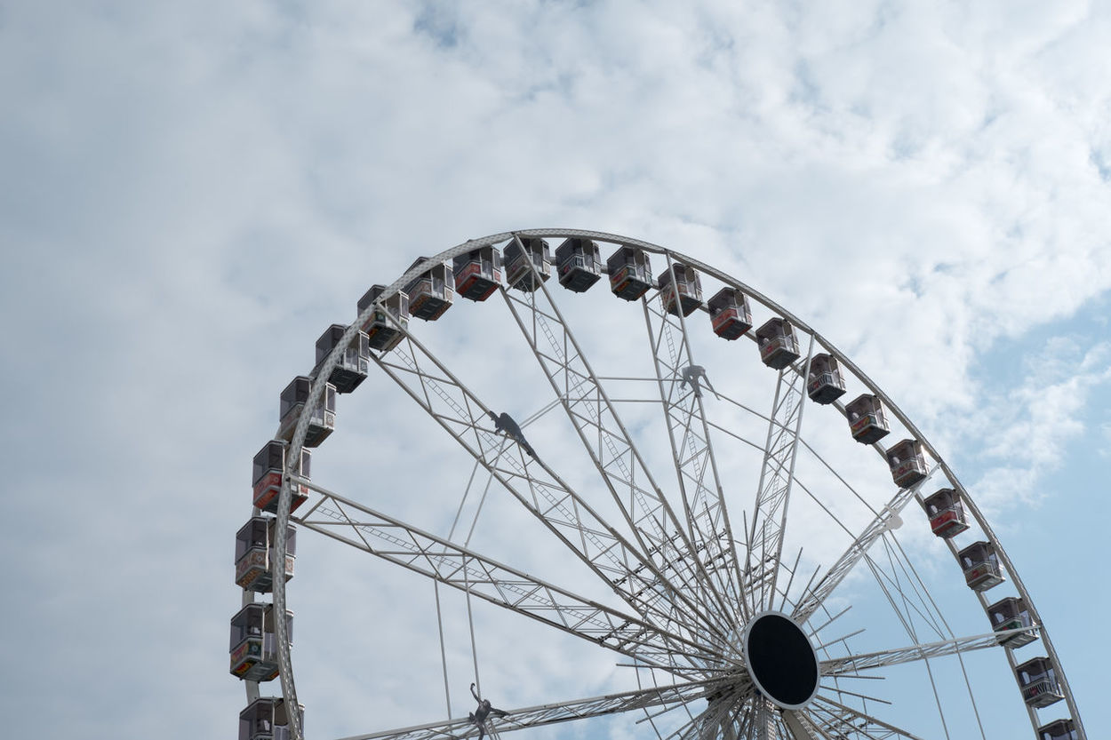 Ferris wheel in Belgium. Blue sky with clouds. Looking up a Ferris wheel in Europe. Antwerp Antwerp, Belgium Antwerpen Antwerpen, Belgium Ferris Wheel Ferris Wheels Amusement Park Amusement Park Ride Arts Culture And Entertainment Big Wheel Cloud - Sky Day Ferris Wheel Low Angle View No People Outdoors Sky