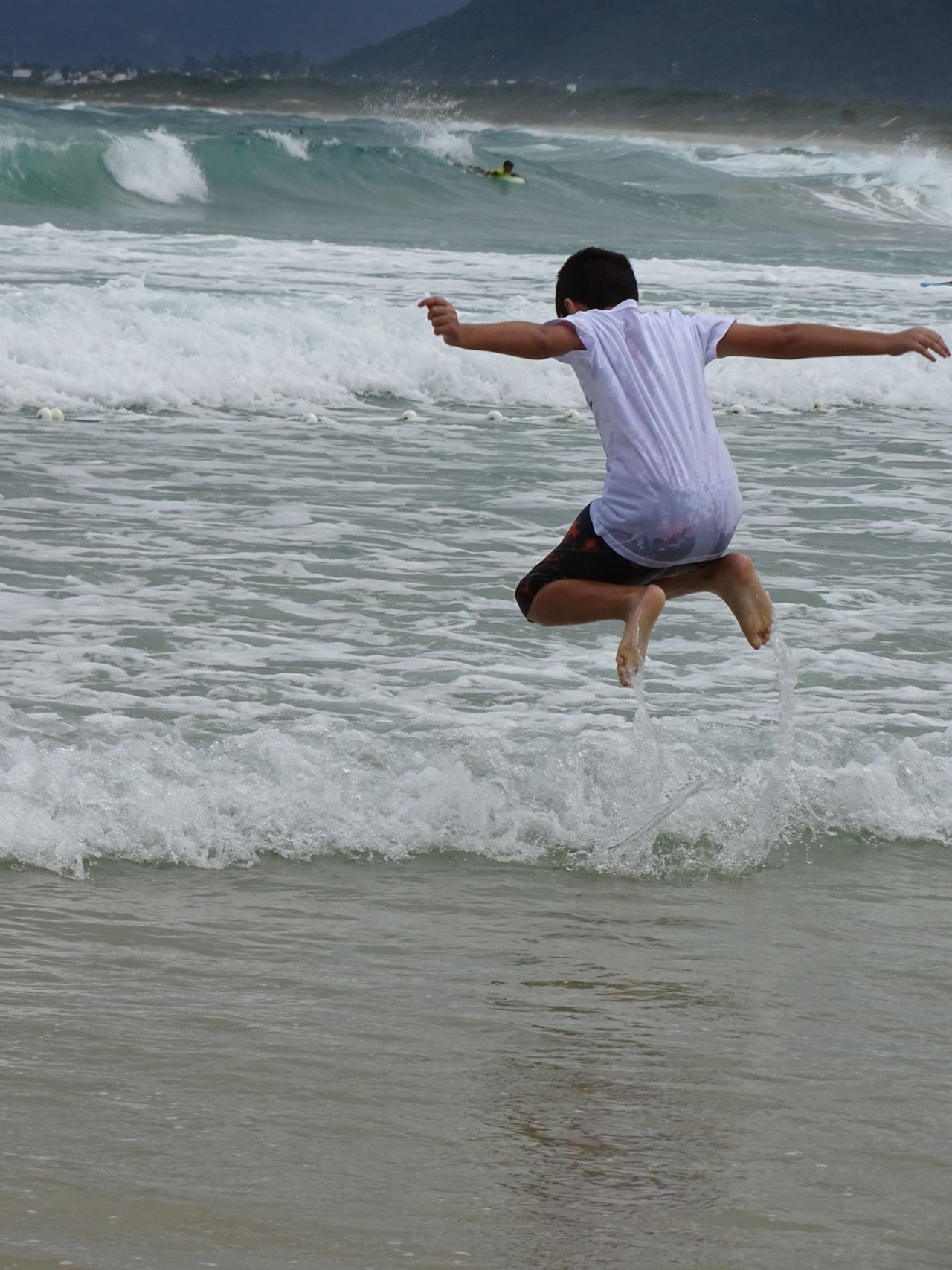 My son jumping on the beach in Florianópolis, Brazil 😎 Sea Freedom Wave Beach One Person Florianópolis Outdoors Rear View Healthy Lifestyle Enjoyment Jumping Wellbeing Lifestyles Motion Nature Full Length Water People Sand Boy Kid
