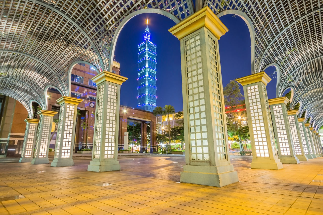 Overlooking East Taipei Mall and Taipei 101 in Xinyi financial district at dusk, Taipei, Taiwan Architectural Column Architecture Building Built Structure Cityscape Destination District Dusk Sky Financial District  Illuminated Indoors  Landmark Landscape Night No People Place Of Worship Religion Skyline Spirituality Taipei 101 Taiwan Tower Towers Urban