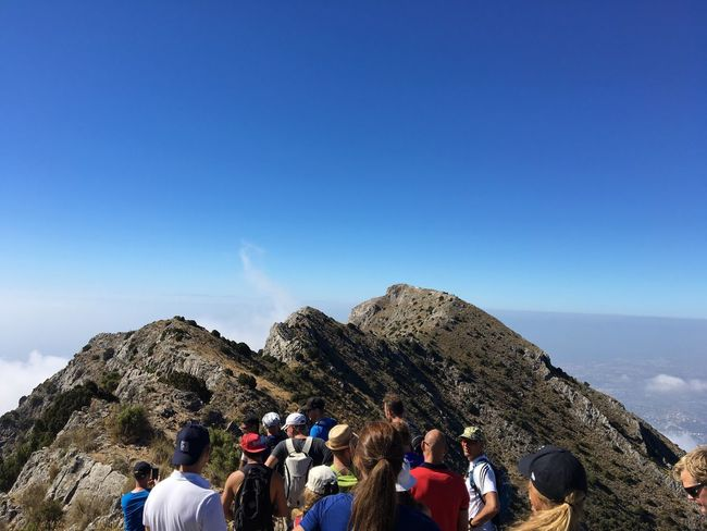 Men Tourist Person Railing Leisure Activity Large Group Of People Vacations Tourism Mountain Standing Blue Tranquility Lifestyles Rear View Observation Point Hiking Sky Scenics Beauty In Nature