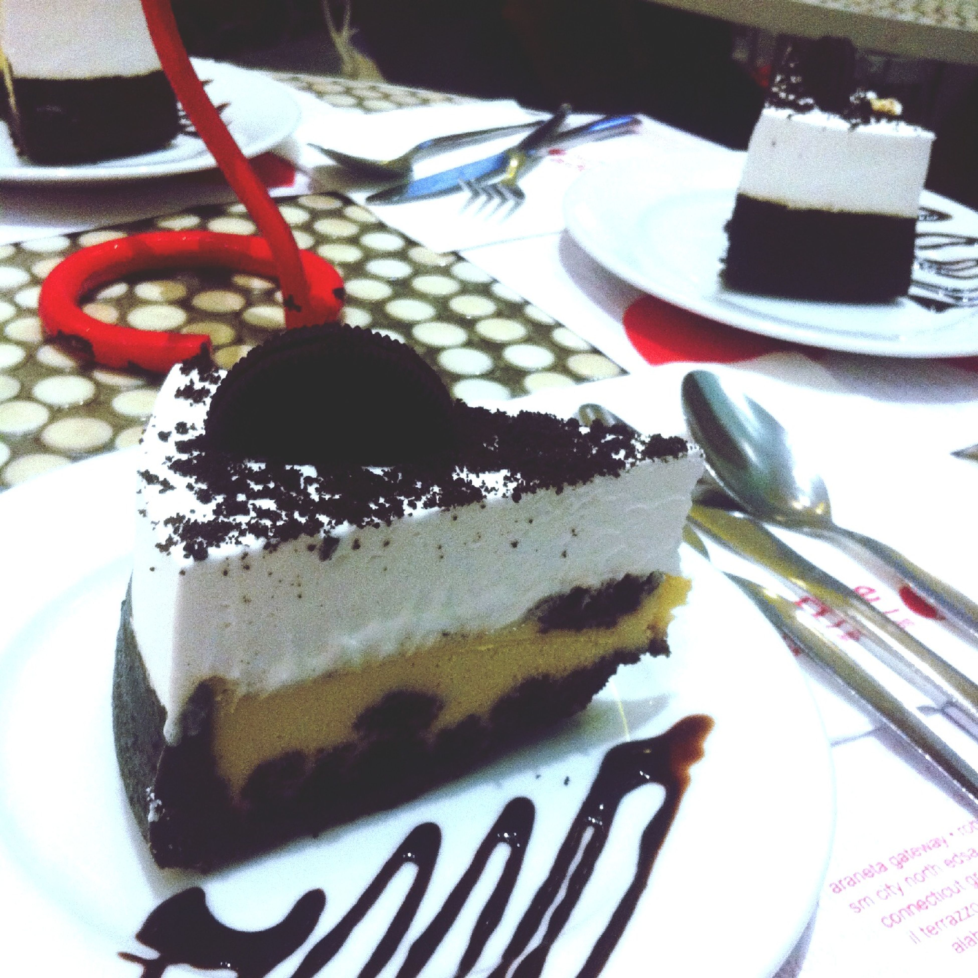 food and drink, indoors, sweet food, dessert, food, table, freshness, still life, plate, indulgence, cake, ready-to-eat, high angle view, close-up, fork, unhealthy eating, chocolate, temptation, serving size, no people