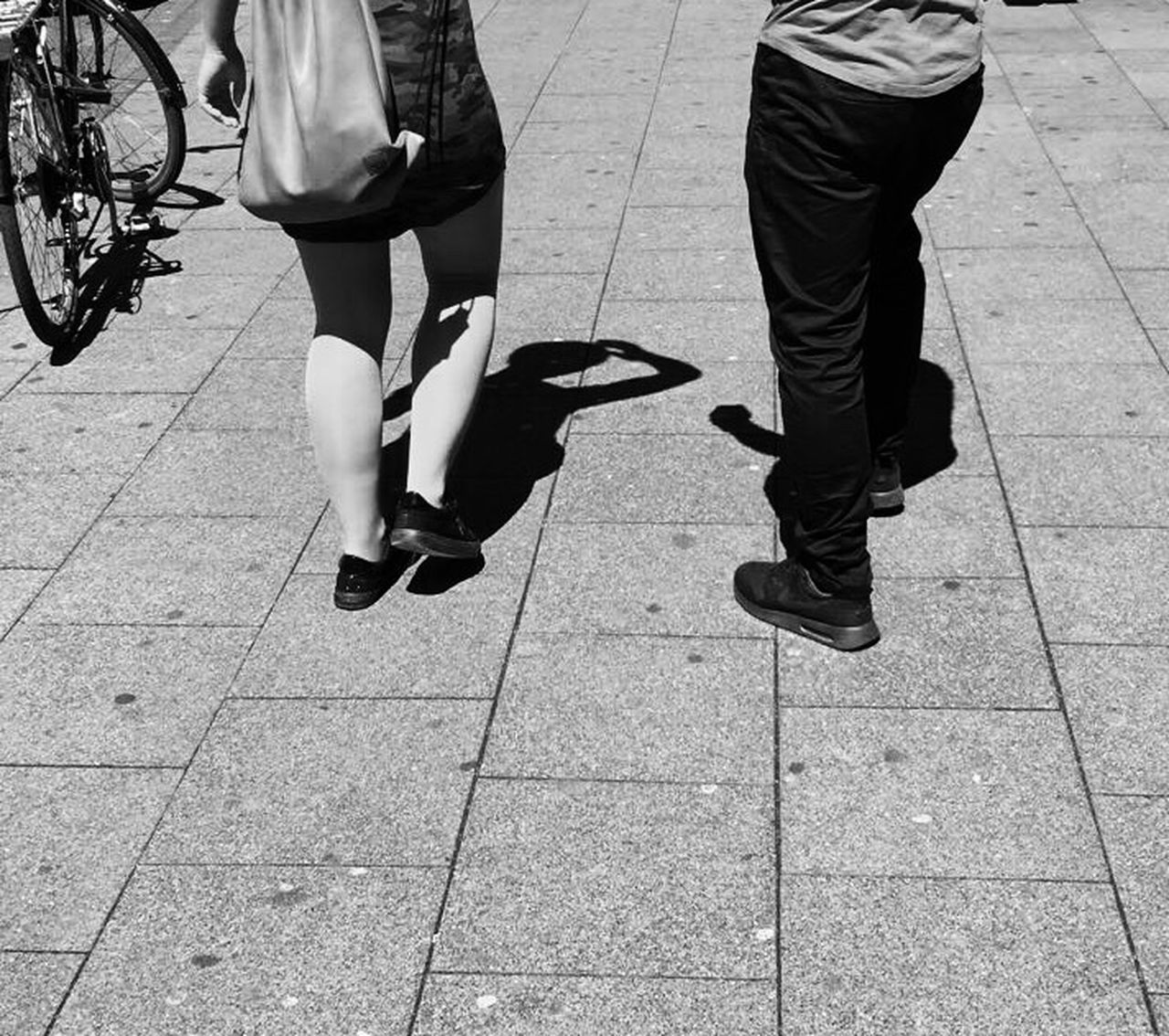 low section, real people, two people, human leg, lifestyles, day, outdoors, men, leisure activity, sunlight, women, togetherness, standing, human body part, friendship, adult, people