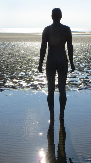 Statue Another Place By Anthony Gormley Beach Beauty In Nature Day Full Length Horizon Over Water Leisure Activity Lifestyles Men Nature Outdoors Rear View Reflection Sand Scenics Sea Silhouette Sky Standing Sunlight Tranquil Scene Tranquility Vacations Water