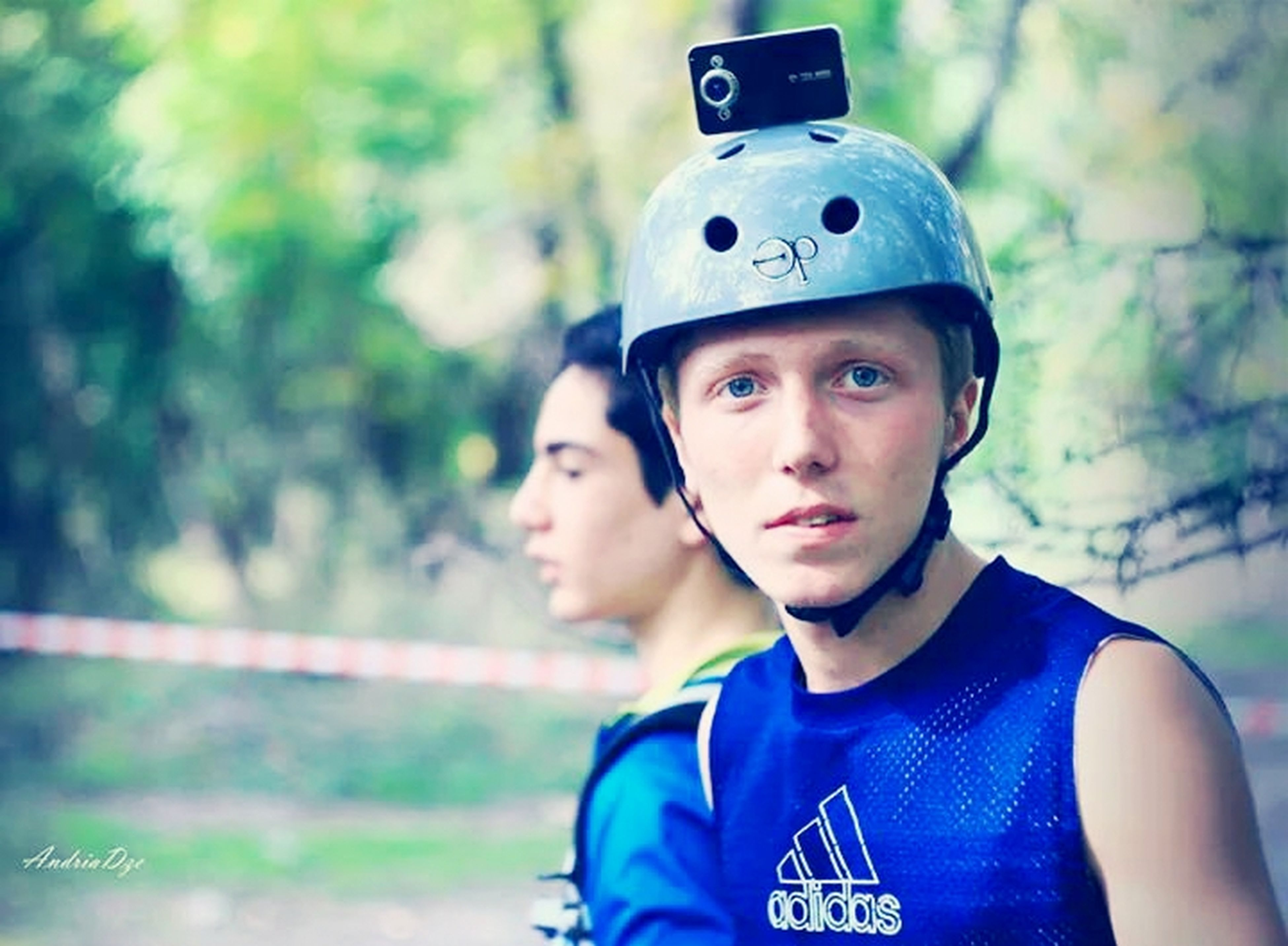 focus on foreground, portrait, person, looking at camera, lifestyles, headshot, front view, leisure activity, boys, childhood, smiling, happiness, casual clothing, cap, close-up, elementary age, young men, waist up
