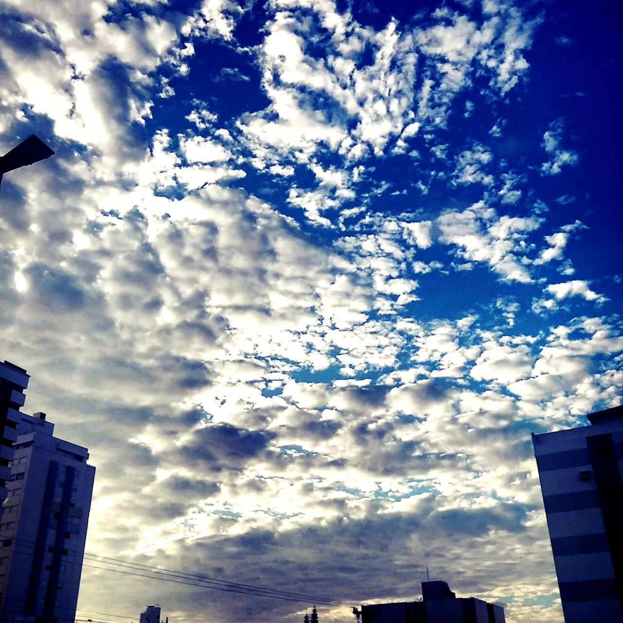 low angle view, architecture, building exterior, no people, sky, cloud - sky, built structure, outdoors, day, city, nature