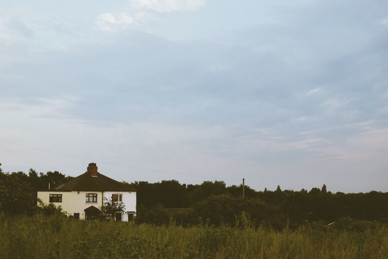 house, built structure, building exterior, architecture, sky, tree, field, outdoors, grass, cloud - sky, tranquility, landscape, growth, no people, scenics, day, nature, beauty in nature