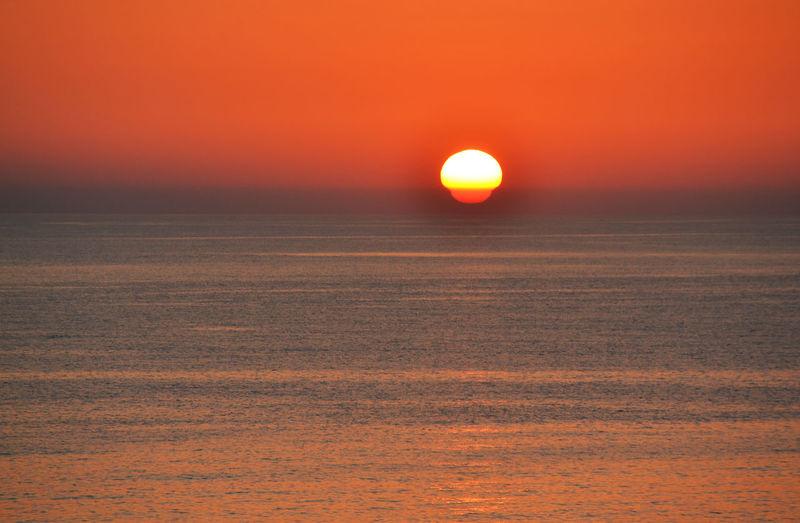 Atmosphere Beauty In Nature Dramatic Sky Idyllic Idyllic Mom Moody Sky Nature No People Non-urban Scene Orange Color Outdoors Romantic Sky Scenics Sea Seascape Sky Sun Sunset Tranquil Scene Vibrant Color Water Waterfront