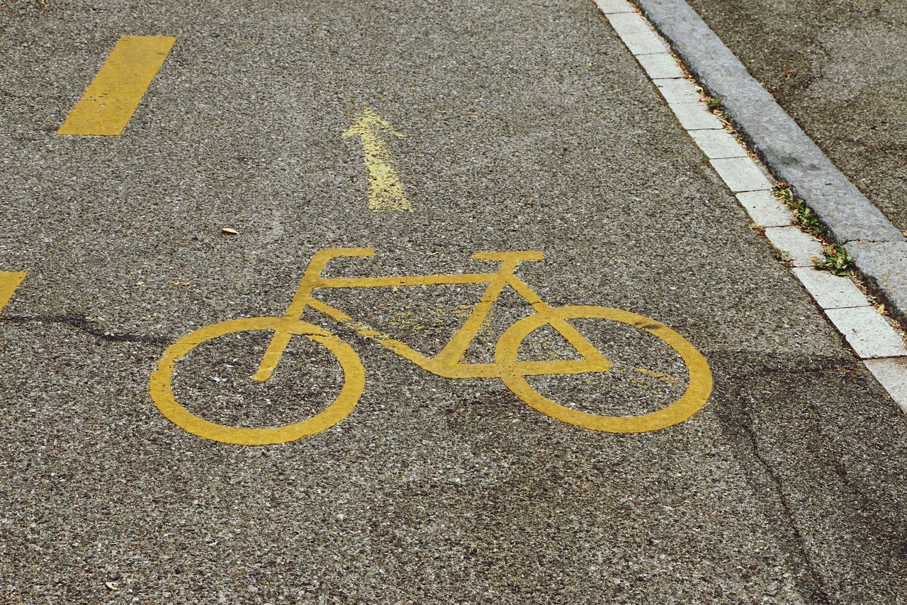 yellow, street, road marking, asphalt, road, transportation, bicycle, no people, outdoors, high angle view, day, communication, bicycle lane, road sign